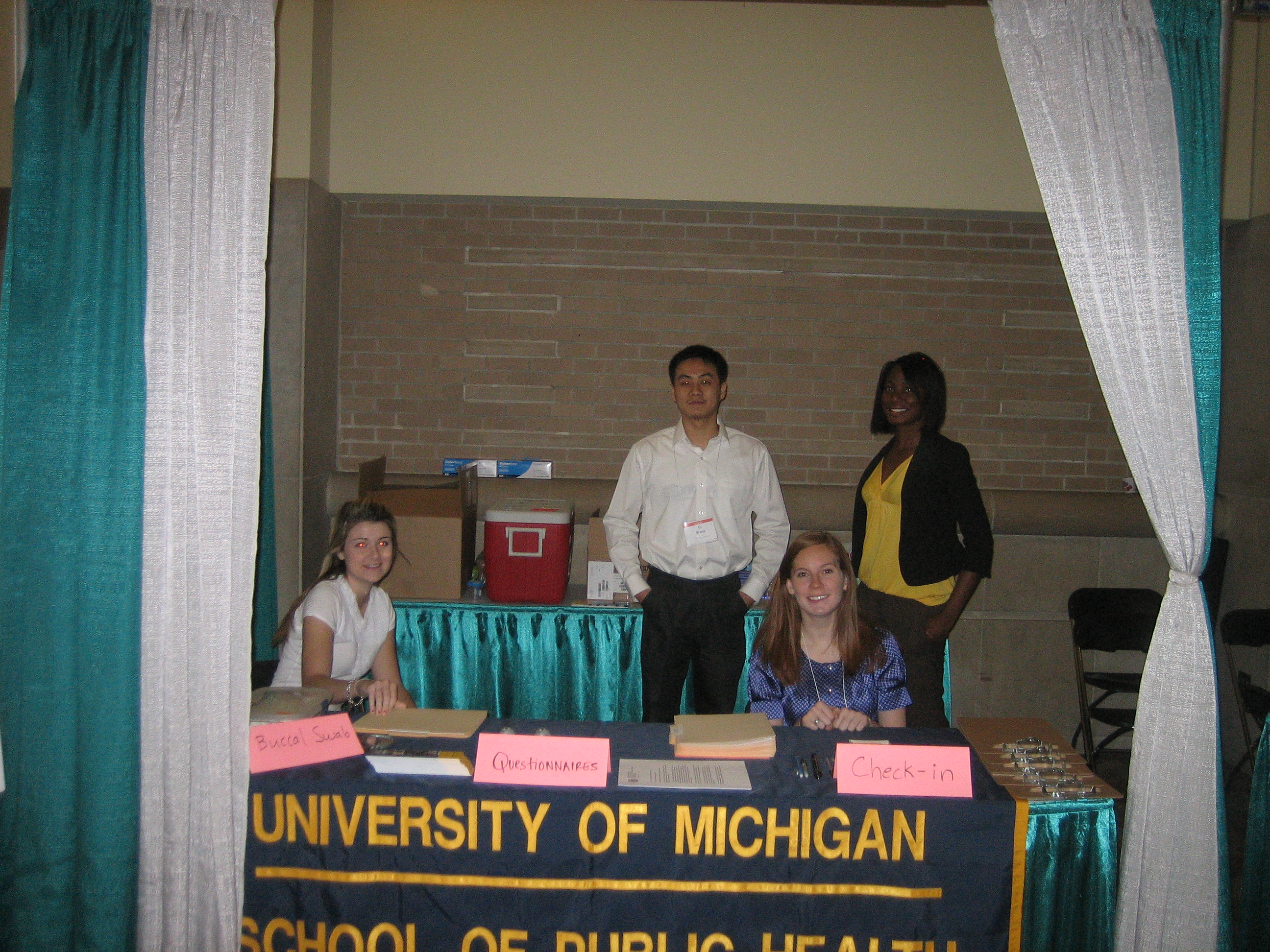 Research team members at the recruitment booth at the Michigan Dental Association conference.