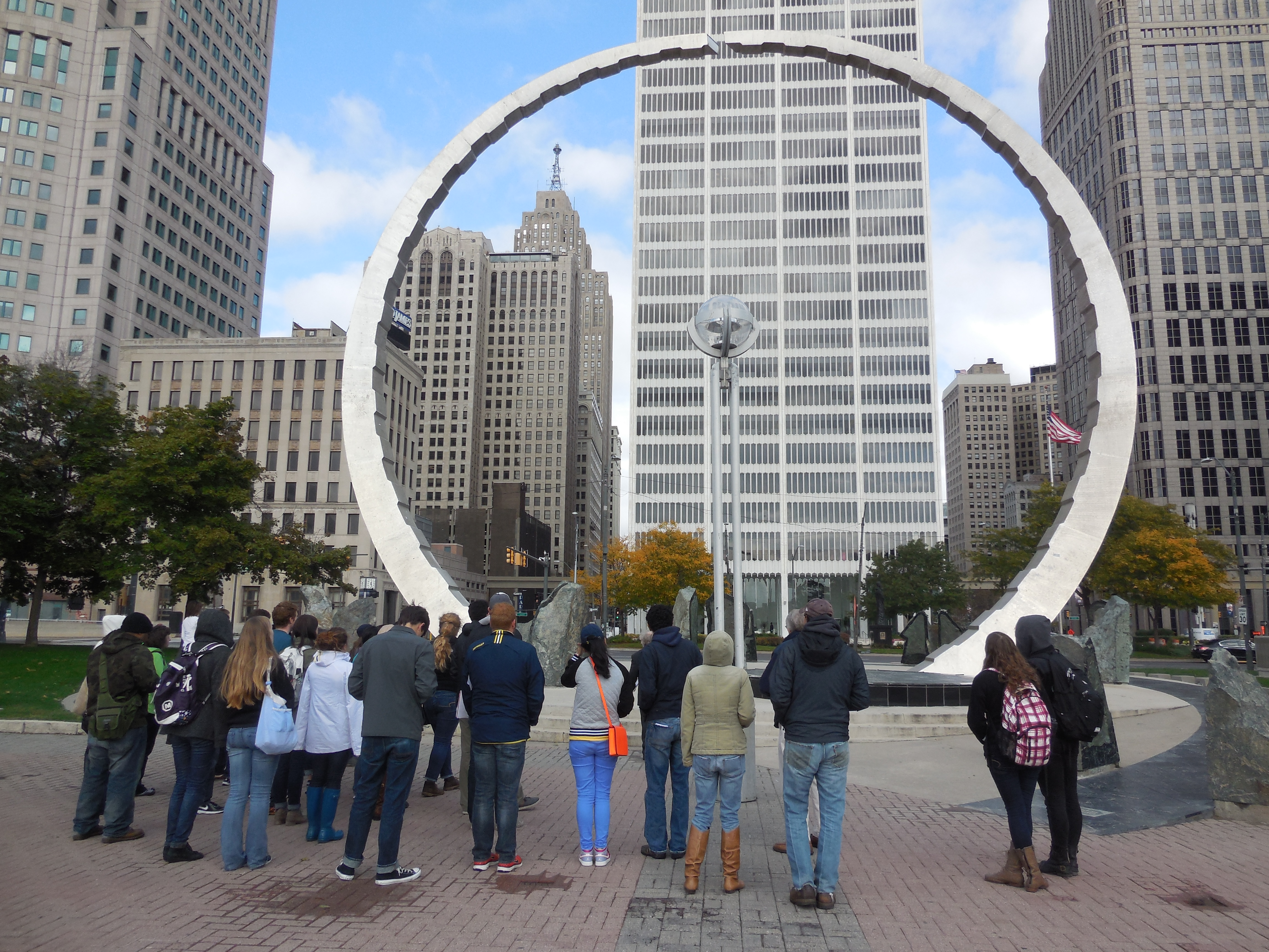 Participants on the Tour of Toxic Sites 2014 gather around the Transcend monument in Hart Plaza, Detroit.