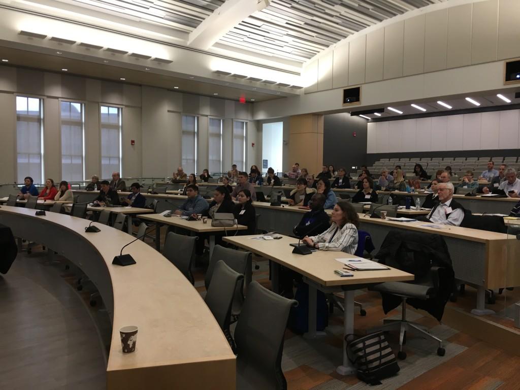 Attendees listen to symposium presentations